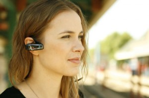 Young woman using bluetooth headset